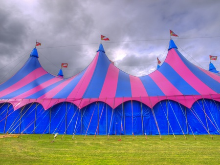 Big top circus tent on a field with brooding sky Stock Photo