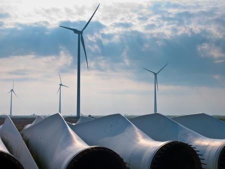 awaiting: wind turbine blades awaiting assembly at wind farm