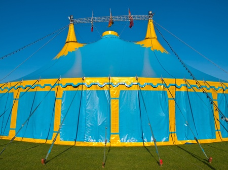 Close up of a  blue and yellow big top circus tent photo