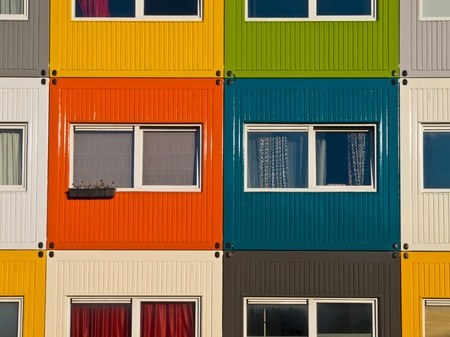 colorful cargo containers used as home by students to  solve housing problem photo