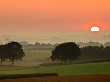 Red sunrise over rural countryside Stock Photo - 11334380