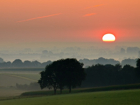 Sun is coming up over farmland Stock Photo - 11334376
