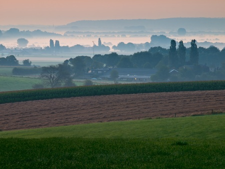 View over hazy farmland in the early morning Stock Photo - 11334430