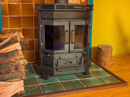 wood stove: Wood stove in front of colorful wall