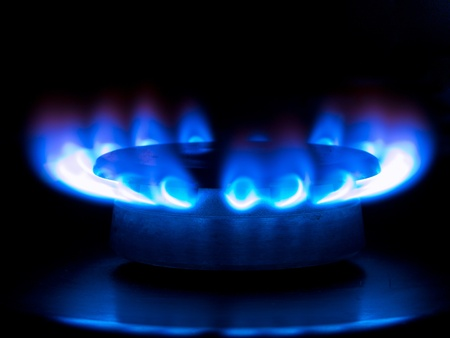 blue flames from a gas stove in the dark photo