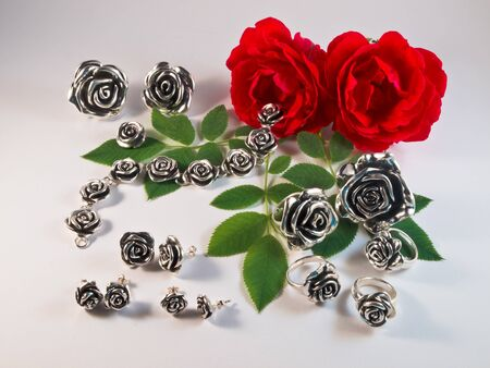 jewelle: Collection of silver rose jewelry Stock Photo