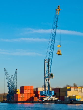 Crane with stacked containers in a harbour photo
