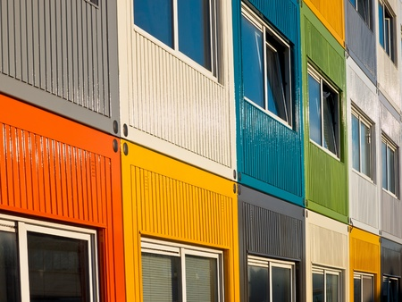 multicolored cargo containers used for housing photo