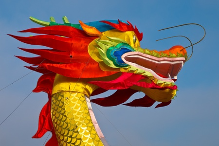dragon head: Multicolored Chinese dragon against blue sky