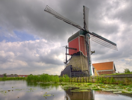 Old hisoric dutch windmill under brooding sky photo
