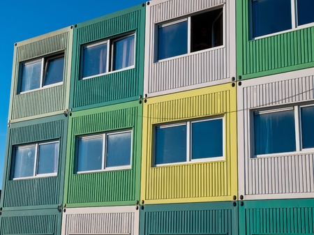 students housing in cargo containers in varied colors photo