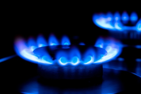 two blue flames from a gas stove in the dark Stock Photo - 12285609