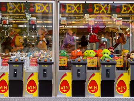 Arcade crane claw machine on an arcade in The Netherlands, Europe photo