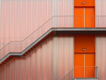 Fire escape stairs on the outside of a modern sports hall photo