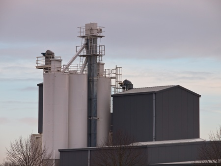Grey factory building with silos photo