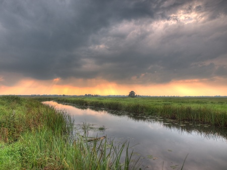 HDR image of dutch lowland river just before a summer storm Stock Photo - 12285709