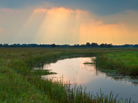 Sunrays are breaking through the clouds above lowland nature reserve Stock Photo - 12285676