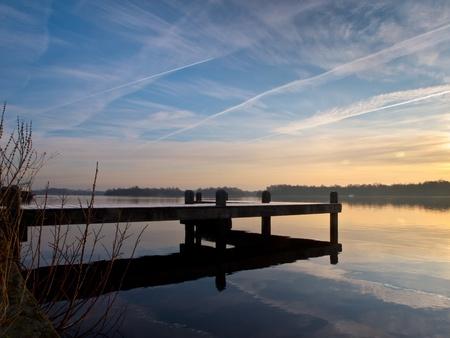 mooring: Pier at dutch lake during winter