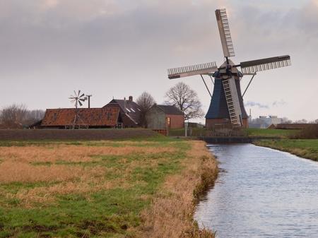polder: Traditional dutch windmill in polder landscape Stock Photo