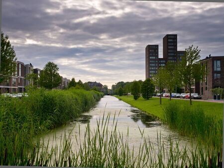 Canal in a dutch suburban residential area photo