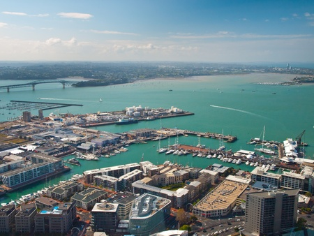 overlook: Aerial view of Auckland harbour on a sunny day with blue sea
