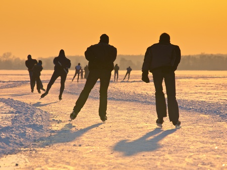 Skaters on a dutch lake seen on their back during the eleven cities tour photo