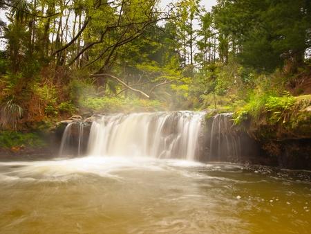 Geothermal waterfall in kerosene creek near Rotorua New Zealand photo