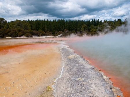 Colorful geothermal champagne pool under cloudy sky in Rotorua, New zealand photo