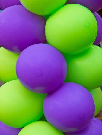 Green and Purple balloon background at a party photo