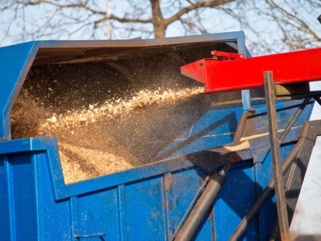 shredder: Wood Chipper Machine Filling Back Of Truck With wood chips