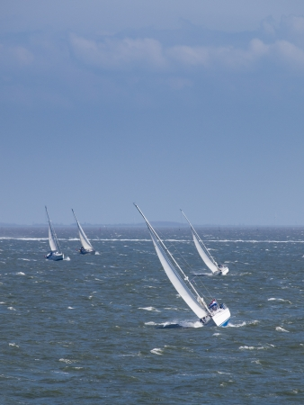 stormy sea: Sailing boat race under stormy conditions