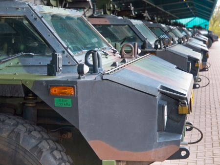 armored: Armored army vehicles lined up in formation Editorial