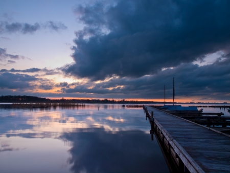 Boats along a jetty during a tranquil sunset Stock Photo - 14617188