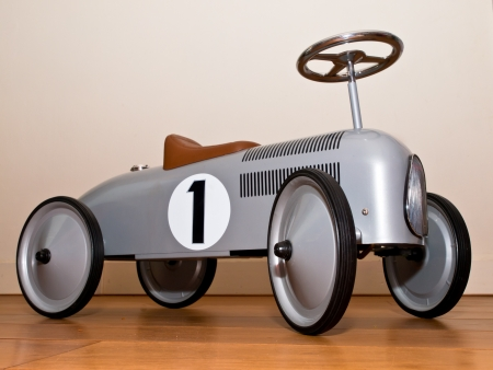Retro style toy car in a living room photo
