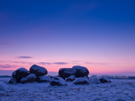 Dolmen with snow in winter landscape photo