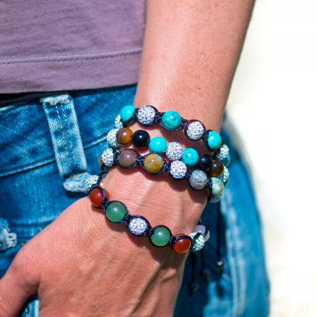Popular Buddhist bracelet shamballa around a models wrist Stock Photo