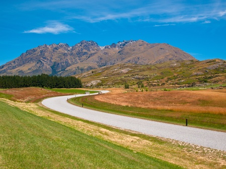 croft: A white road through the New zealand countryside near queenstown Stock Photo
