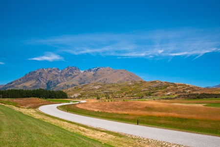 A white road through the New zealand countryside near queenstown photo