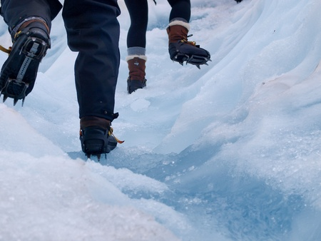 crampons: Detail of crampons of tourists on the Franz Josef Glacier, West coast, New Zealand Stock Photo