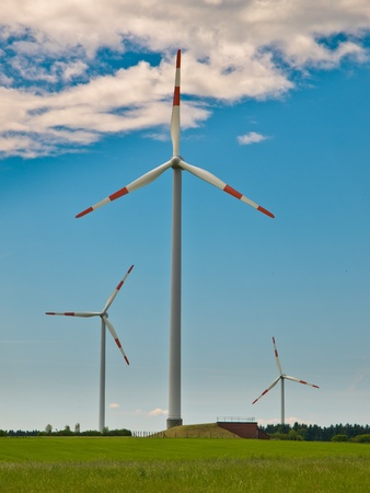 windfarm: Wind Turbines in a Windfarm on top of a Hill in Germany Stock Photo