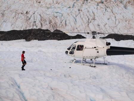 icecaps: Helicopter landing on Franz josef glacier in New Zealand