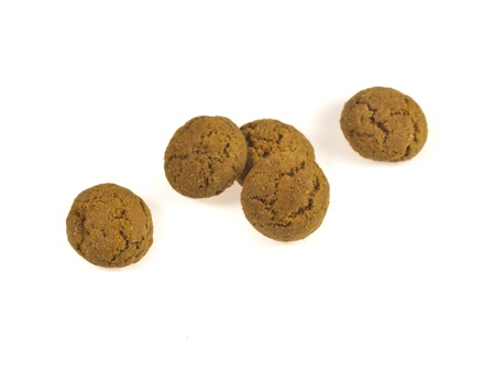 Pile of Pepernoten, typical Dutch treat for Sinterklaas in december, over White Background Stock Photo - 16627169