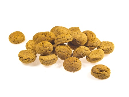 sinterklaasfeest: Pile of Pepernoten, typical Dutch treat for Sinterklaas in december, over White Background