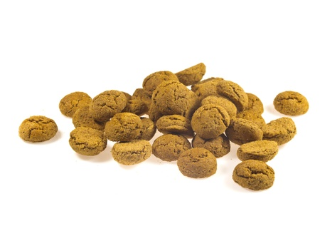 Pile of Pepernoten, typical Dutch treat for Sinterklaas in december, over White Background Stock Photo - 16627218