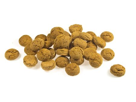 Pile of Pepernoten, typical Dutch treat for Sinterklaas in december, over White Background Stock Photo - 16627219