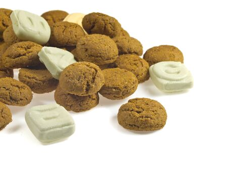 Pile of Pepernoten, typical Dutch treat for Sinterklaas in december, over White Background Stock Photo - 16627386
