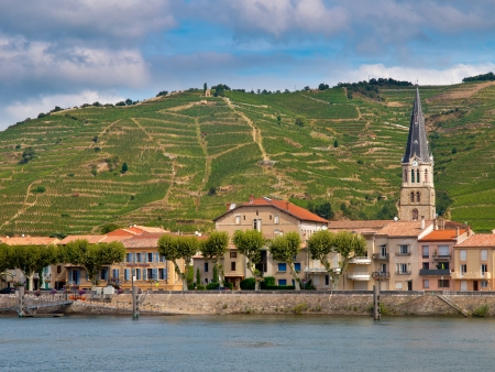 rhone: A riverside Village and Vineyards on the Hills of the Cote du Rhone Area in France