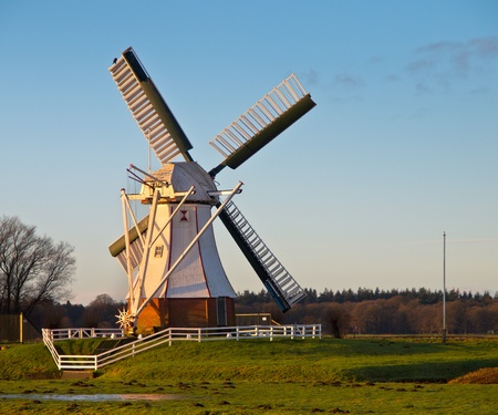 White Wooden Windmill in Dutch Polder Landscape Stock Photo - 17324746