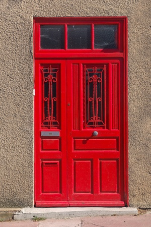 Architecture Detail of a Red Door in France Stock Photo - 17382347