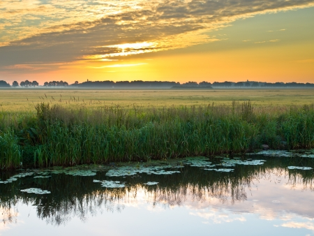 rural area: Canal in the Morning in Rural Area in the Netherlands Stock Photo